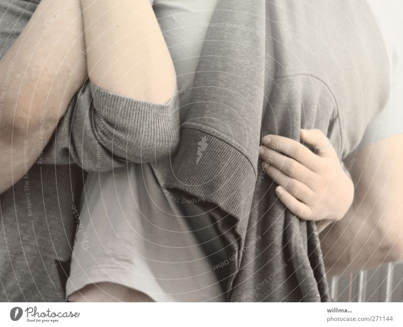 young couple hug each other Young woman Youth (Young adults) Young man Couple Arm Hand 2 Human being 18 - 30 years Adults T-shirt Sweater Touch To hold on Love