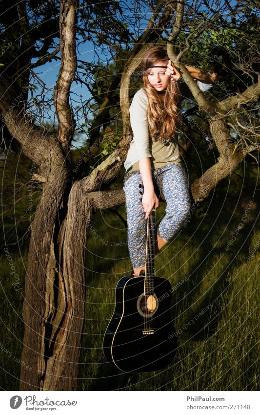 Uninspired? Leisure and hobbies Young woman Youth (Young adults) 1 Human being 18 - 30 years Adults Artist Music Musician Guitar Nature Tree Garden Meadow