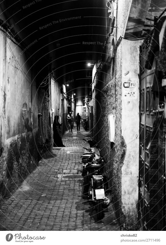 alley hustle Human being Masculine Feminine Woman Adults Man 3 Town Old town Alley Burka Headscarf Going Stand Wait Dark Creepy Historic Belief
