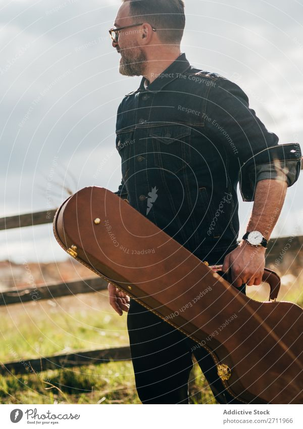 Adult man with guitar case Man Guitar Nature Musician To fall Stand Looking away Adults Rural Fence Lifestyle Human being Summer Easygoing Acoustic handsome Guy