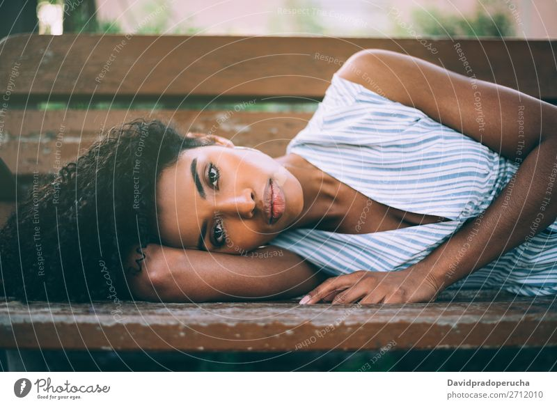 Beautiful young black woman laying down on a chair in a park Woman Beauty Photography Close-up Portrait photograph multiethnic Black African