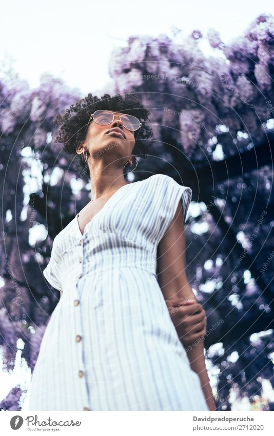 Happy young black woman surrounded by flowers Woman Blossom Spring Lilac Portrait photograph Flower Black African