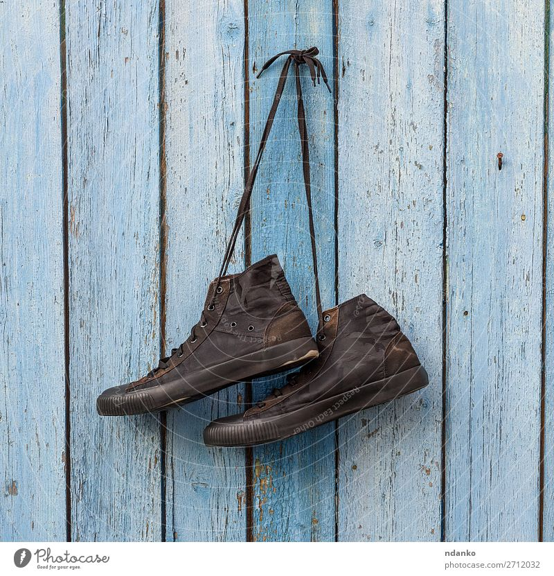 pair of black textile sneakers Old Blue Black Lifestyle Wood Sports Style Fashion Retro Modern Dirty Footwear Clothing Hang Rustic Sneakers