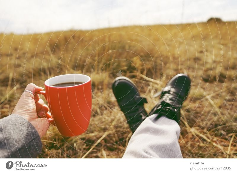 One people holding a cup of coffee or soluble cereals Vacation & Travel Nature Red Hand Relaxation Calm Black Lifestyle Natural Health care Freedom Nutrition