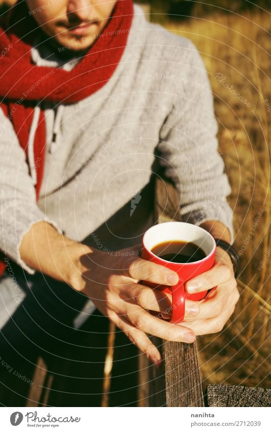 One people holding a cup of coffee or soluble cereals Human being Nature Man Summer Red Hand Relaxation Calm Black Healthy Lifestyle Adults Autumn Natural