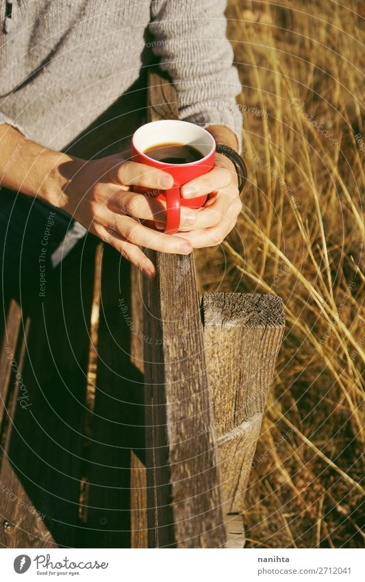 One people holding a cup of coffee or soluble cereals Nature Red Hand Relaxation Calm Black Healthy Lifestyle Warmth Yellow Natural Health care Nutrition Free