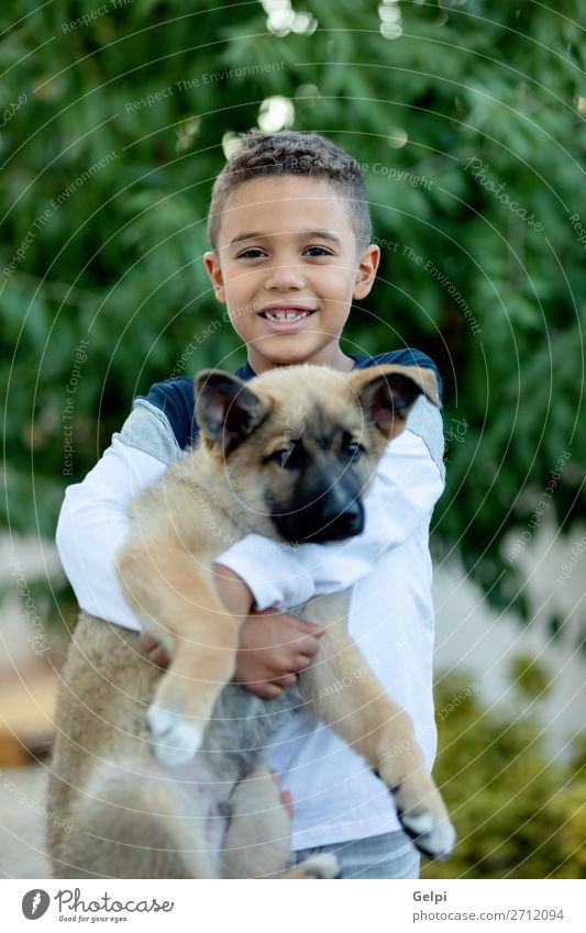 Latin child with his dog Lifestyle Joy Happy Face Relaxation Leisure and hobbies Child Human being Boy (child) Man Adults Family & Relations Friendship Infancy