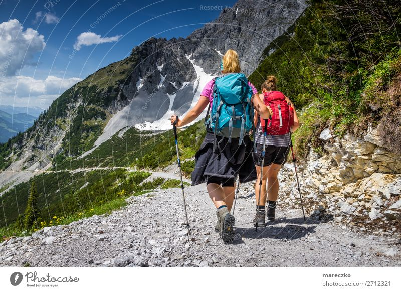 Two women with hiking equipment Fitness Leisure and hobbies Tourism Trip Adventure Summer Summer vacation Mountain Hiking Sports Training Nature Landscape Alps