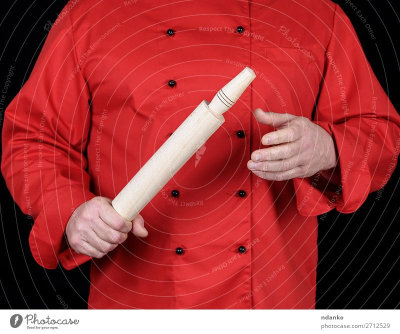 cook in a red uniform holding a wooden rolling pin Kitchen Restaurant Work and employment Profession Cook Human being Man Adults Hand Clothing Shirt Suit Jacket