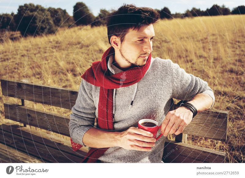 Young man enjoying a sunny morning drinking a cup of coffee Human being Man Summer White Red Relaxation Loneliness Calm Adults Life Autumn Freedom Masculine