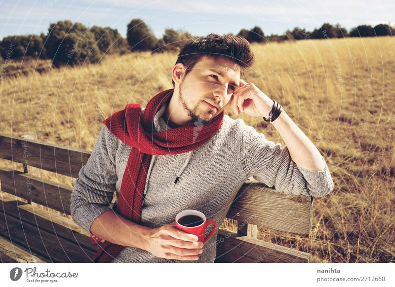 Young man enjoying a sunny morning drinking coffee Human being Man Summer White Red Relaxation Loneliness Calm Adults Life Autumn Freedom Masculine Dream Field