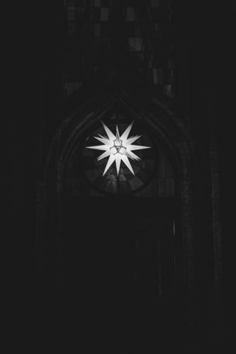 Herrnhuter Stern hangs from a church in Advent Christmas & Advent Facade Hang Hope Tradition Advent star Herrnhuter Star Church window Christmas star