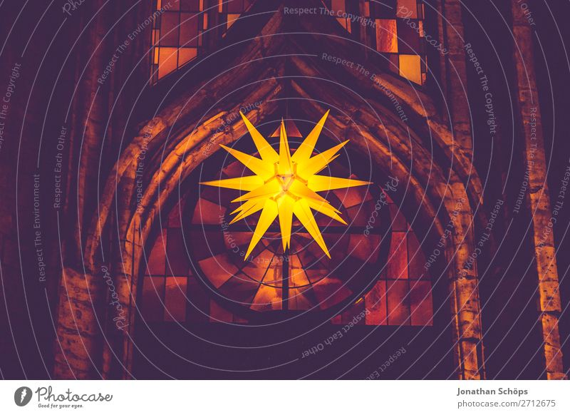Herrnhuter Stern hangs from a church in Advent Christmas & Advent Facade Hang Retro Yellow Violet Hope Tradition Advent star Herrnhuter Star Church window