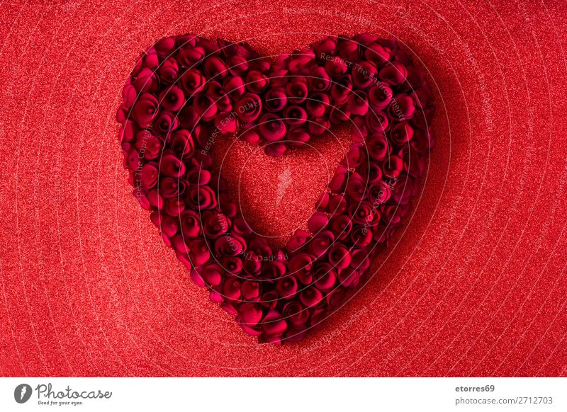 Heart made of red roses on red bright background Valentine's Day Love Mother's Day Rose Flower Symbols and metaphors Feasts & Celebrations Vacation & Travel