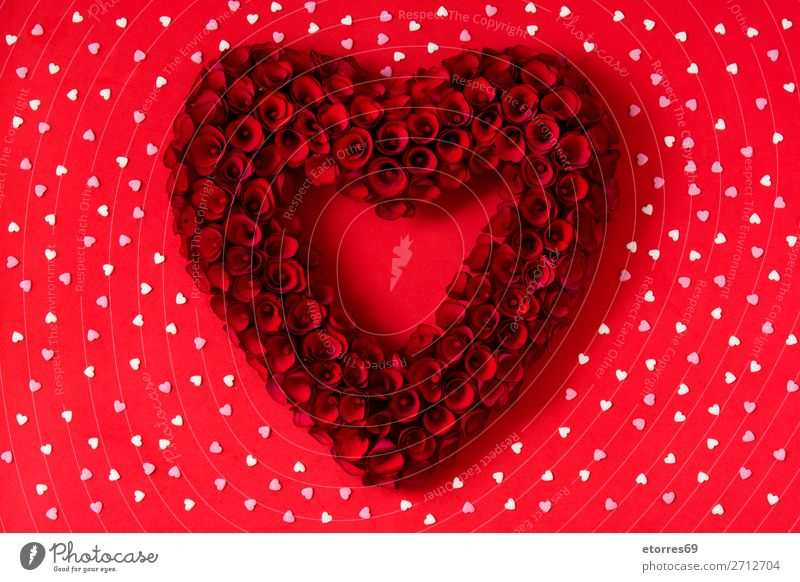 Heart made of red roses on red background for Valentine's Day Love Mother's Day Rose Flower Symbols and metaphors Feasts & Celebrations Public Holiday February