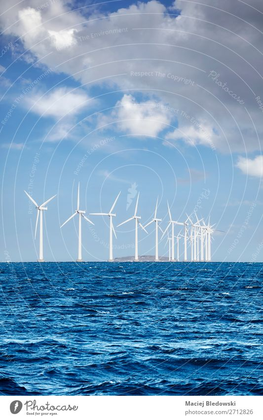 Offshore windmill farm on a sunny day Ocean Industry Energy industry Renewable energy Wind energy plant Environment Nature Sky Clouds Horizon Sustainability