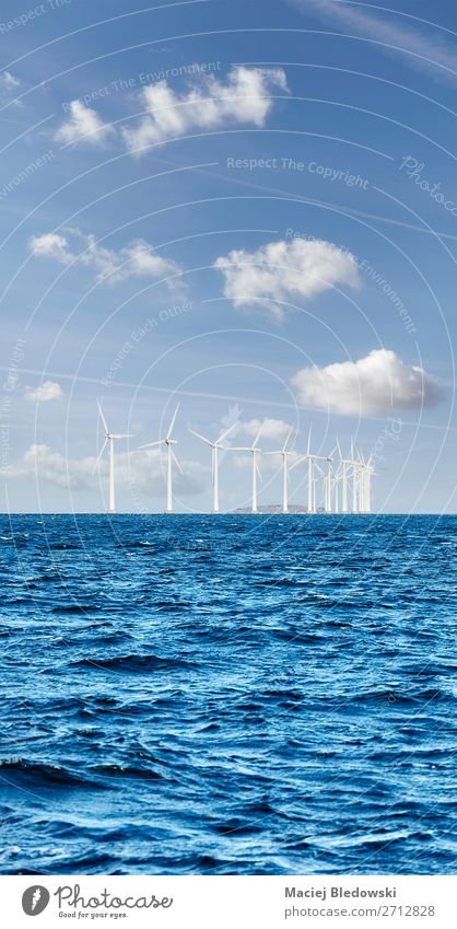 Offshore windmill farm on a sunny day Ocean Industry Energy industry Renewable energy Wind energy plant Environment Nature Sky Clouds Horizon North Sea