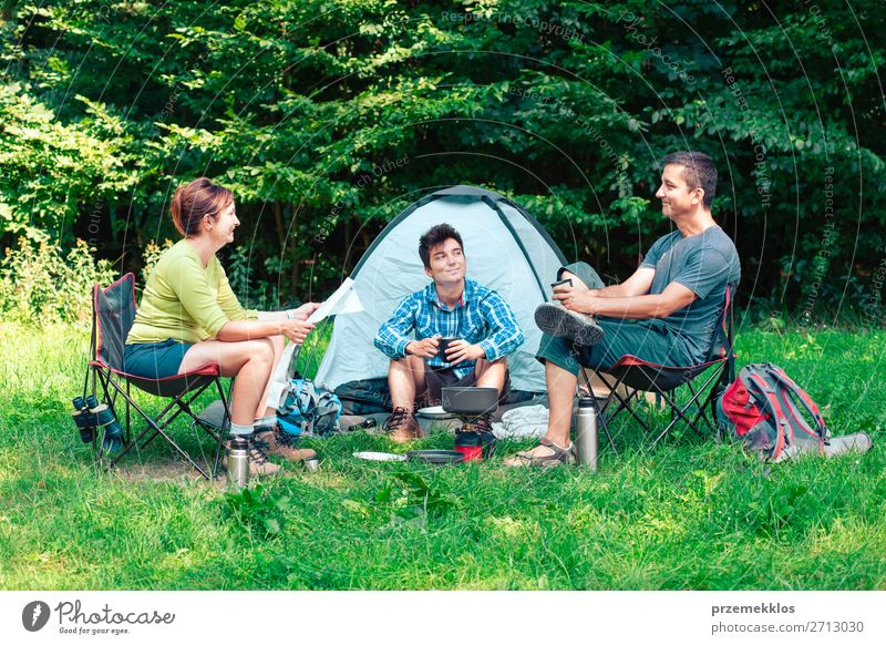Spending a vacation on camping Lifestyle Relaxation Vacation & Travel Tourism Adventure Camping Woman Adults Man 3 Human being Group 30 - 45 years Nature Sit