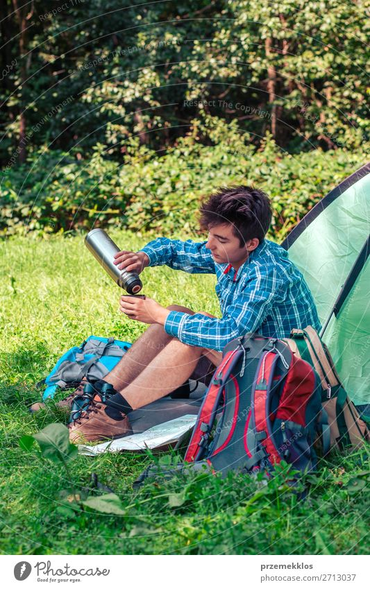 Spending a vacation on camping Lifestyle Relaxation Vacation & Travel Tourism Trip Adventure Camping Summer vacation Young man Youth (Young adults) Man Adults 1