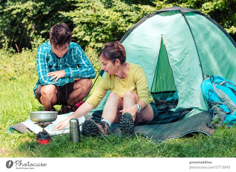 Spending a vacation on camping Lifestyle Relaxation Vacation & Travel Tourism Trip Adventure Camping Summer vacation Woman Adults Man 2 Human being Nature Sit