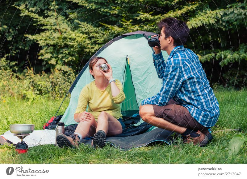 Spending a vacation on camping Lifestyle Relaxation Vacation & Travel Tourism Adventure Camping Young man Youth (Young adults) Woman Adults Man 2 Human being