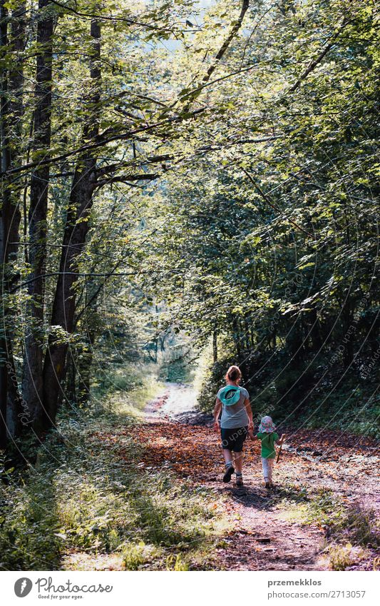 Mother with daughter walking through the forest Woman Child Human being Vacation & Travel Nature Summer Plant Landscape Tree Relaxation Joy Forest Girl