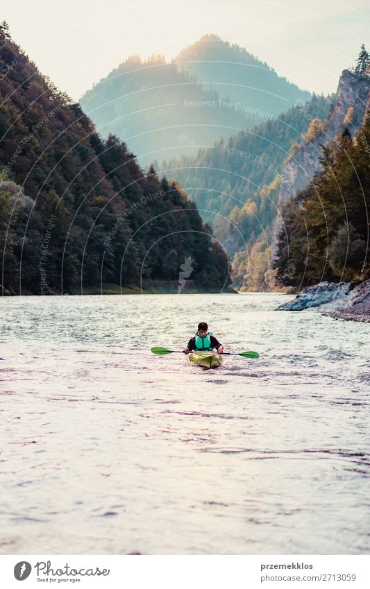 Young man kayaking on the Dunajec river Human being Sky Vacation & Travel Nature Youth (Young adults) Man Summer Landscape Tree Relaxation Joy Far-off places