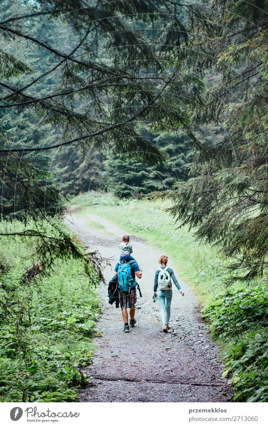 Family spending vacation on wandering with backpacks Woman Child Human being Vacation & Travel Nature Youth (Young adults) Man Young woman Summer Plant