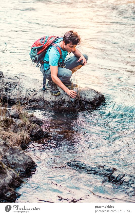 Young wanderer takes pure water from a river Human being Nature Youth (Young adults) Man Summer Blue Young man 18 - 30 years Adults Life Environment Natural