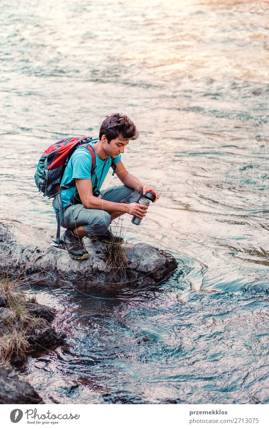 Young wanderer takes pure water from a river Human being Vacation & Travel Nature Youth (Young adults) Man Summer Blue Young man 18 - 30 years Adults Life