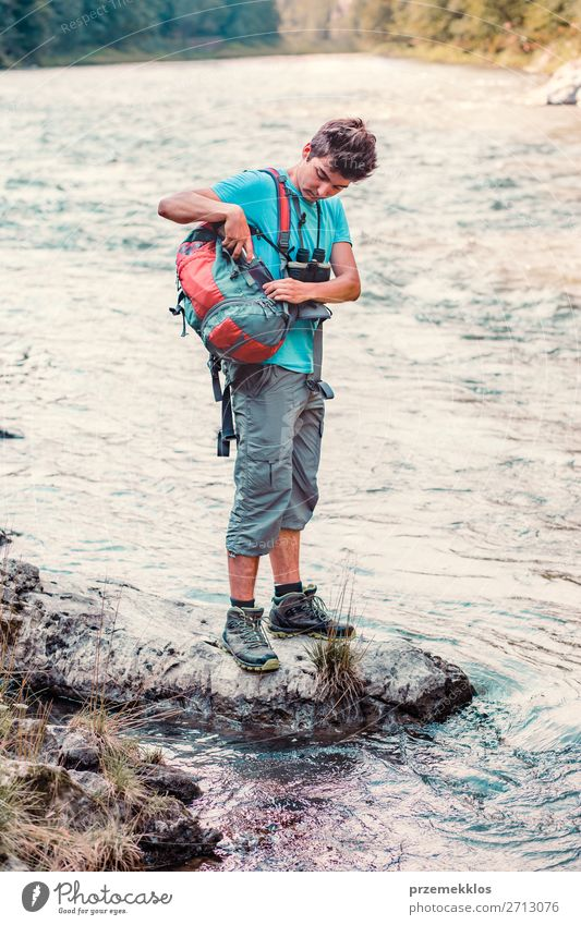 Young boy takes out outdoor mug to take pure water from a river Life Trip Adventure Summer Hiking Human being Boy (child) Young man Youth (Young adults) Man