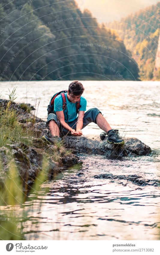 Young boy taking pure water from a river Lifestyle Body Vacation & Travel Tourism Trip Adventure Summer Mountain Hiking Human being Boy (child) Young man