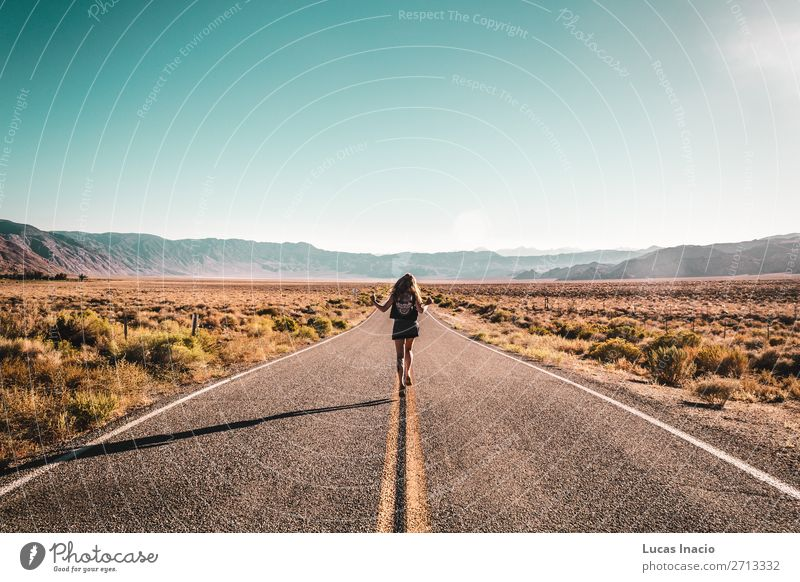 Girl in the middle of Route 66 Lifestyle Vacation & Travel Tourism Trip Adventure Freedom Sightseeing Summer Summer vacation Sun Mountain Garden Human being