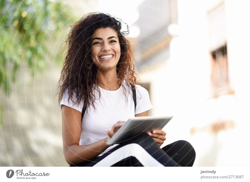 Smiling African woman using digital tablet outdoors Lifestyle Style Happy Beautiful Hair and hairstyles Tourism Technology Internet Human being Feminine
