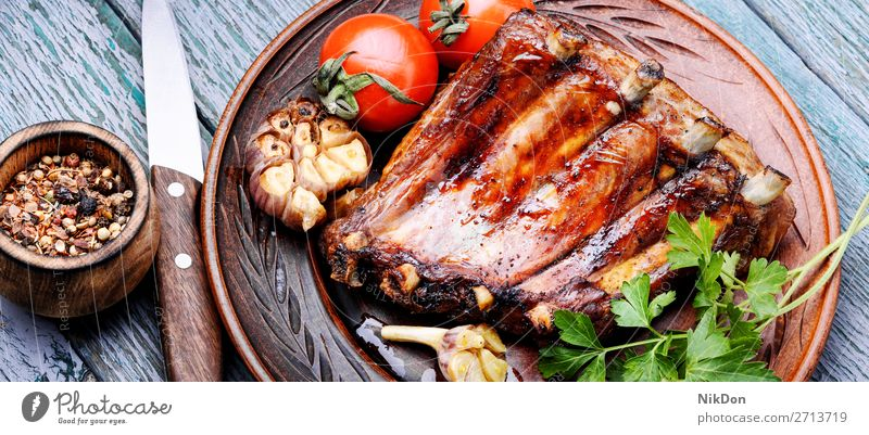 Tasty roasted ribs meat food bbq grilled barbecue pork dinner wooden pork rib cuisine rustic board spicy marinated american fat delicious bone smoked dark baked