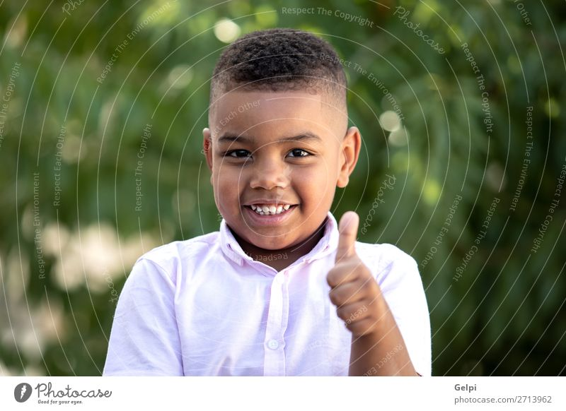 Happy child covering his eye Lifestyle Joy Face Playing Child Human being Boy (child) Man Adults Infancy Happiness Small Funny Cute Black Emotions Concern