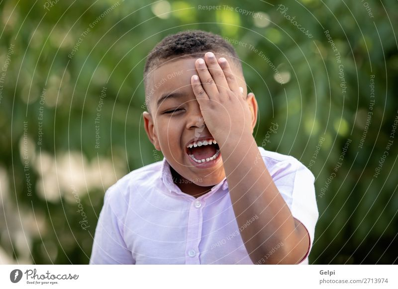Happy child covering his eye in the park Lifestyle Joy Face Playing Child Human being Boy (child) Man Adults Infancy Happiness Small Funny Cute Black Emotions