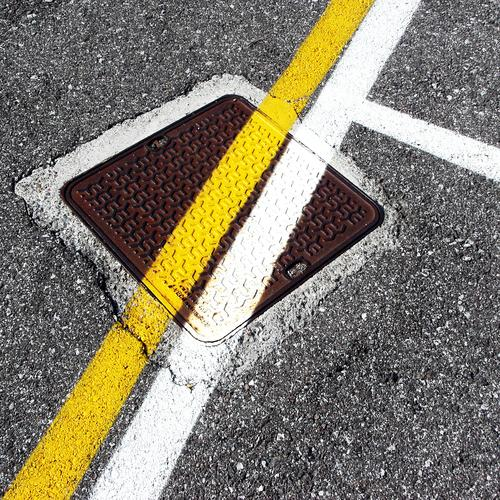 street art | on the road again Construction site Street Asphalt Tar Gully Dye Line Stripe Safety Protection Relationship Design Discover Resolve Expectation