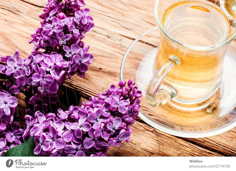 Cup of tea and lilac flowers herbal tea cup mug springtime drink table blossom fresh aroma natural leaf petal pink healthy floral bloom bouquet beautiful