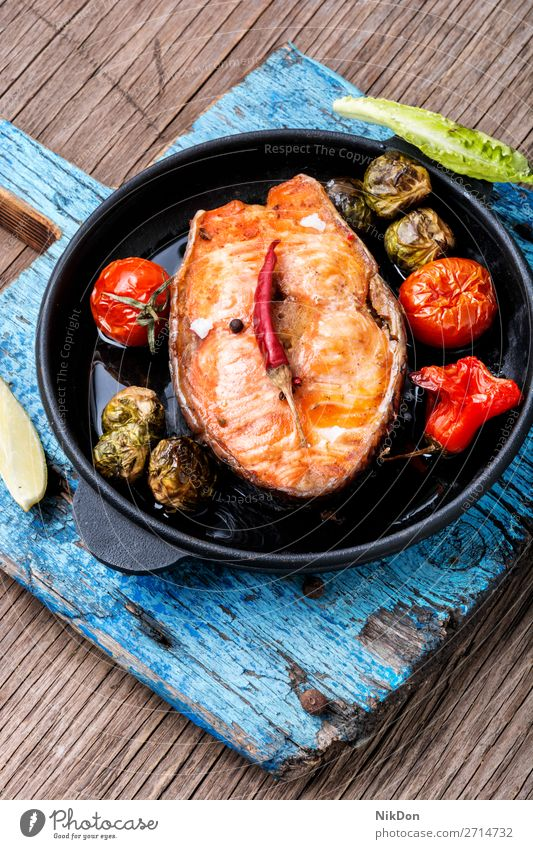 Salmon roasted in pan fish grilled salmon steak baked salmon frying pan seafood healthy meal fish steak vegetable cutting board diet prepared pepper portion