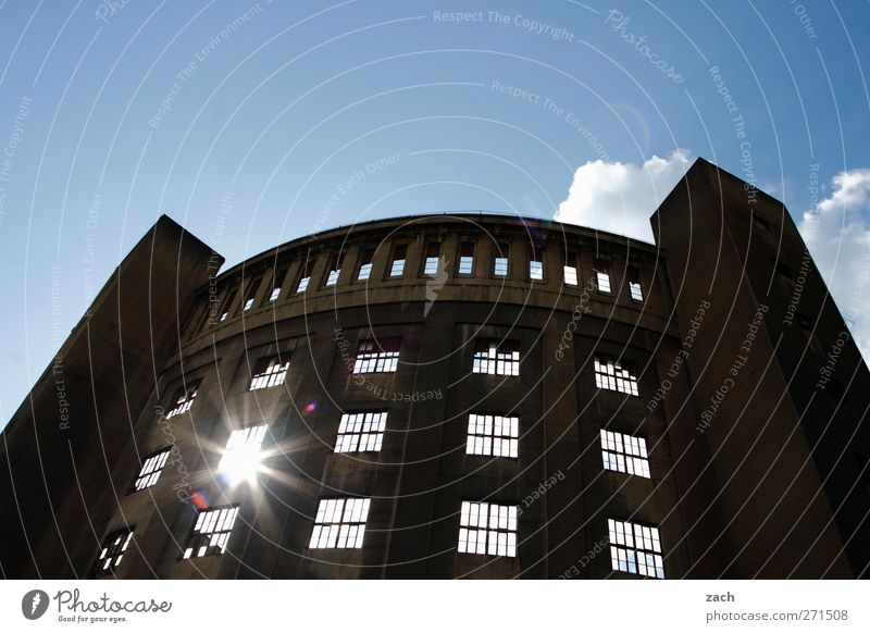 wink Energy industry Sky Sun Sunlight Beautiful weather Deserted Manmade structures Building Architecture Gasometer Facade Window Tower Old Blue Transience