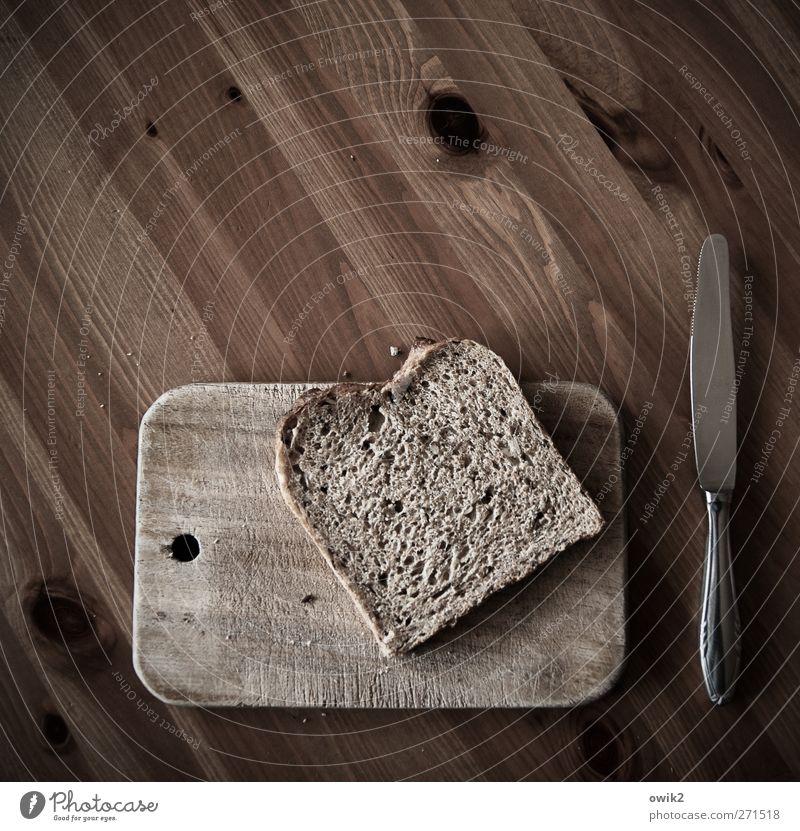 Cold kitchen Food Bread Slice of bread slice sliced bread Nutrition Breakfast Diet Knives Chopping board Tabletop Wood Wooden board Wooden table Metal Lie