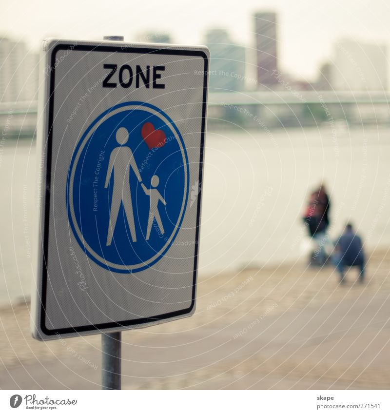family zone Town Populated Places Pedestrian Road sign Emotions Humanity Watchfulness Tolerant Far-off places Rotterdam Colour photo Exterior shot Day