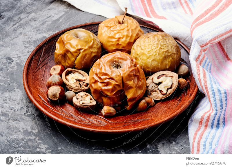 Baked apples with nuts baked dessert food fruit sweet baked apple rural delicious healthy plate christmas walnut red autumn homemade sugar recipe traditional