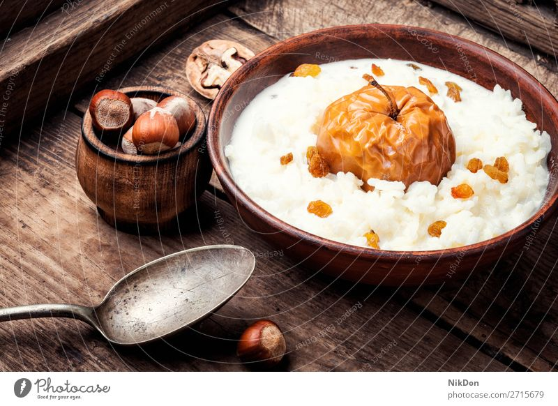 Rice porridge with apples rice porrige food bowl healthy breakfast meal sweet rustic rustic food white table diet delicious traditional homemade milk grain