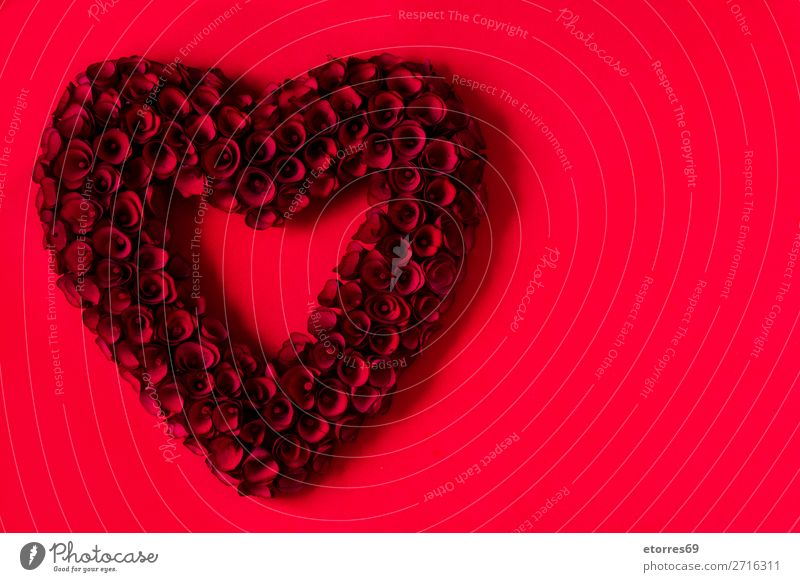 Heart made of red roses on red background for Valentine's Day. Love Mother's Day Rose Flower Symbols and metaphors Feasts & Celebrations Vacation & Travel