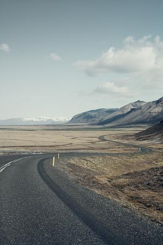 a long way Vacation & Travel Tourism Trip Adventure Far-off places Freedom Mountain Sky Iceland Europe Deserted Street Nature Logistics Lanes & trails