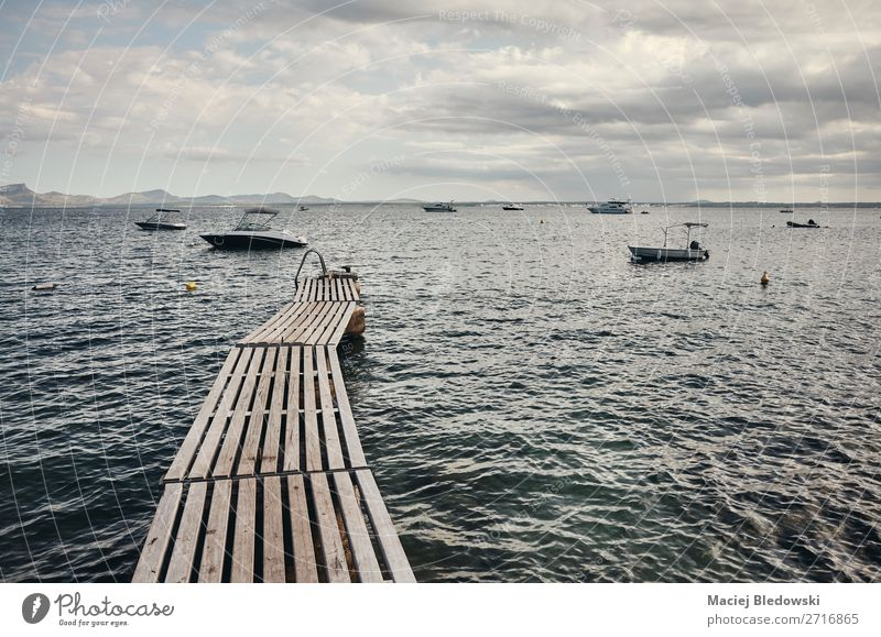Wooden pier at the coast of Mallorca. Sky Vacation & Travel Nature Summer Landscape Ocean Relaxation Calm Far-off places Coast Tourism Freedom Watercraft Moody