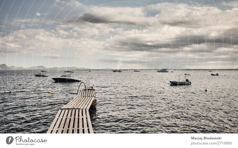Wooden pier at the coast of Mallorca. Sky Vacation & Travel Nature Summer Landscape Ocean Relaxation Far-off places Lifestyle Coast Tourism Freedom Trip Horizon