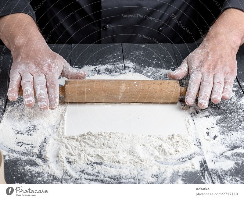 wooden rolling pin in male hands Dough Baked goods Bread Table Kitchen Profession Cook Human being Man Adults Hand Wood Make Fresh Black White Baker Bakery